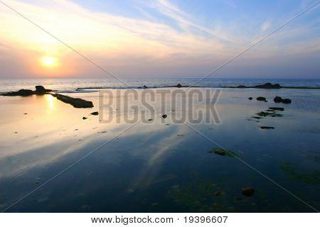 Autumn sunset above the sea