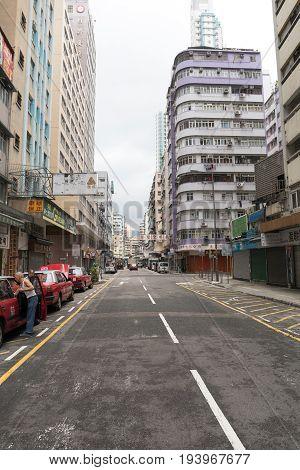 KOWLOON HONG KONG - APRIL 21 2017: Empty Deserted Street at Morning in Kowloon Hong Kong.