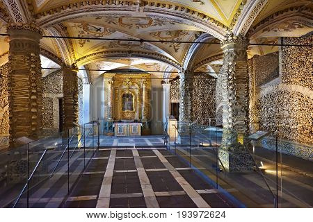 Evora, Portugal - June12 2017: Chapel of the Bones (Capela dos Ossos) with human bones and skulls in the wall is one of the best known monuments in Evora Alentejo Portugal