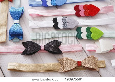 Set of colorful elastic decorated headbands. Bright handmade hair accessories with felt bow and star decoration. Beauty, fashion, style concept