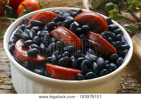 Feijoada, a stew of beans with beef and pork, which is a typical Brazilian dish originated with the slaves in Brazil