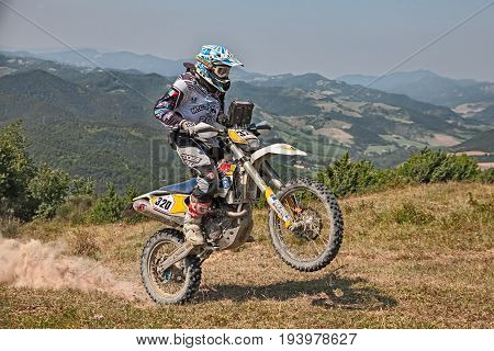 PREDAPPIO, ITALY - JULY 5: biker riding enduro motorcycles Husqvarna 450 in the green mountains during the Italian championship Motorally Terre di Romagna, on July 5, 2015 in Predappio, FC, Italy
