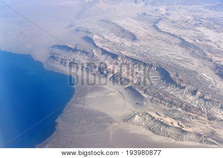 Aerial View On Coast Where Desert Meet With Blue Ocean