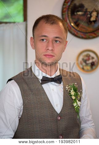 Portrait of the groom on their wedding day.