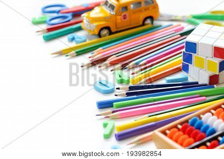 Close up view colorful back to school supplies border over white table. Mental arithmetic. Space for text.