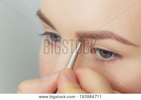 Girl Getting Brow Color To Eyebrows With Brown Brush
