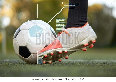 sport, football and technology - soccer player playing with ball on field