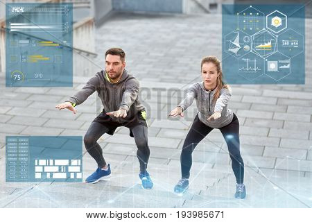 fitness, sport and people concept - man and woman doing squats outdoors