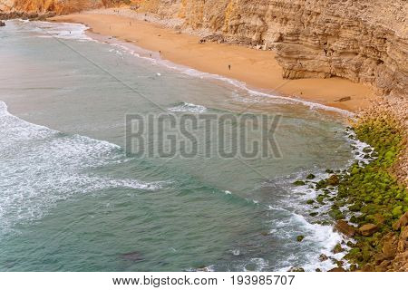 SAGRES, PORTUGAL - AUGUST 25, 2016: People at the beach of Sagres. This beach is a part of famous tourist region of Algarve.