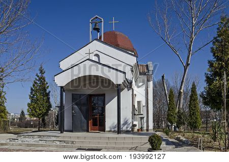 Beautiful  landscape with springtime tree and small beauty church, located in Drujba district, Sofia, Bulgaria