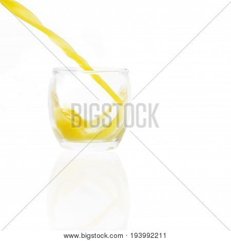 isolated juice pouring in a glass on a white background orange in color angle of liquid can be added to any juicer or object