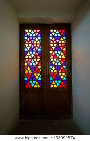 Eastern stained-glass windows old glass doors with colored stained glass. Oriental ornament