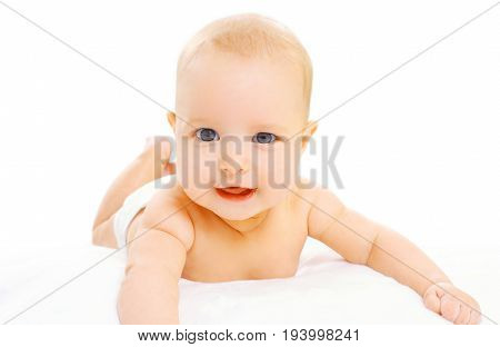 Portrait Of Cute Baby In Diapers Lying On A White Background