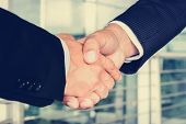 Handshake of businessmen - greeting dealing mergers and acquisition concept poster