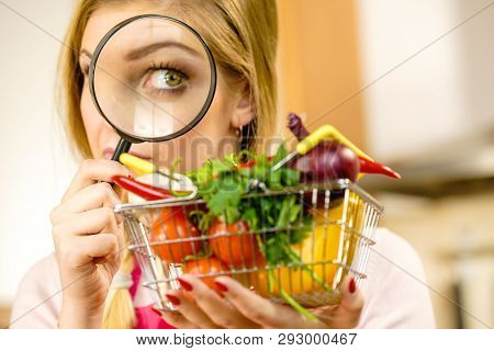 Woman Using Magnifying Glass Loupe, Investigating Shopping Basket With Many Colorful Vegetables. Hea