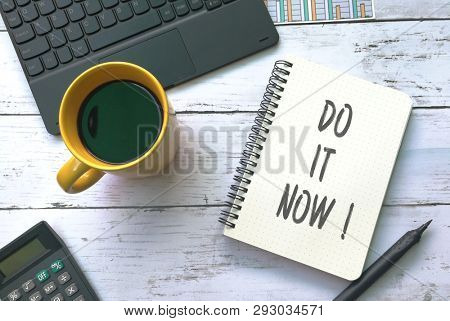 Do it now, written on notebook