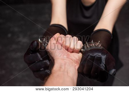 Male Strong Hand Hold Chained Female Wrists