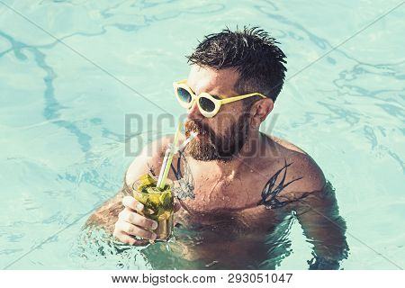 Summer Vacation At Miami Beach Or Maldives. Pool Party With Hipster In Blue Water. Man Swimming And