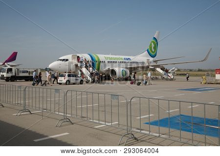 BUDAPEST, HUNGARY - SEPTEMBER 17, 2015: Transavia Boeing 737-800 airliner flight to Rotterdam boarding at Budapest Liszt Ferenc Airport. Transavia is a Dutch low-cost airline, a subsidiary of KLM.