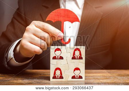 The Businessman Insures And Protects The Business Team Of Employees. Team Insurance, Protection. Pro