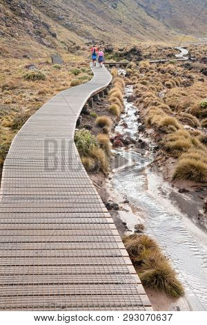 Wooden boardwalk at Tongariro Alpine Crossing tramping track, one of the most popular day hikes in New Zealand. Track crossing the Tongariro National Park, the oldest national park