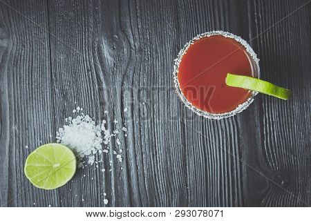 Cocktail Bloody Mary Or Caesar With Lemon And Lime On A Black Wood Background