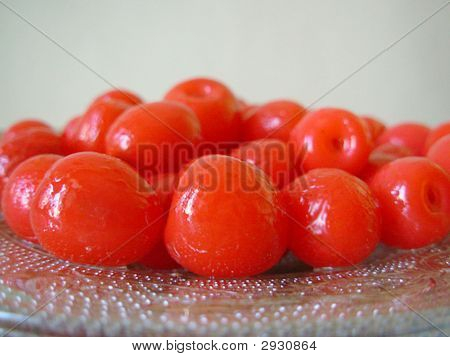 Close-up of red cherries on a glass