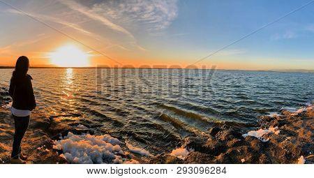 San Jose, California (usa) - March 29, 2019. Lady Enjoying The Beautiful Sunset At Lake Alviso Marin