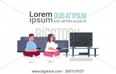 Fat Obese Couple Holding Joystick Game Pad Overweight Family Man Woman Plying Video Games On Tv Scre