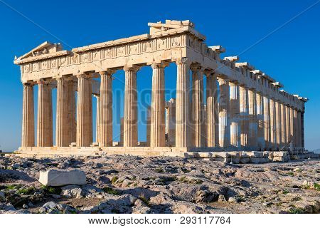 Parthenon Temple At Morning Light With Blue Sky In The Background, Acropolis, Athens, Greece.