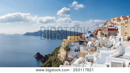 Panoramic View Of Santorini Island. Blue And White Domed Churches On Santorini Greek Island, Oia Tow