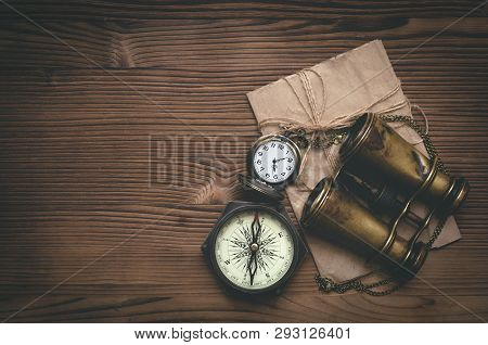 Travel Or Adventure Flat Lay Background With Copy Space. Adventurer Table. Binoculars, Envelope With