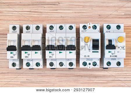 poster of Modular electric circuit breakers, RCD and differential automatic. Residual current device and differential switch with test buttons. Modern and reliable product line. Compact version.