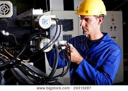 modern industrial machine operator working on machine