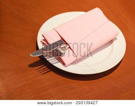Pastel Cloth Napkin (serviette) Folding With Cutlery (knife, Fork, Silverware) In White Plate Prepar