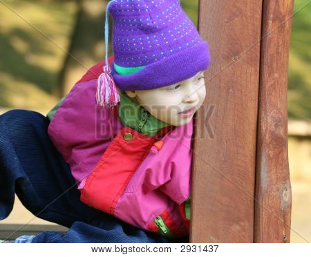 Small Girl In The Playground