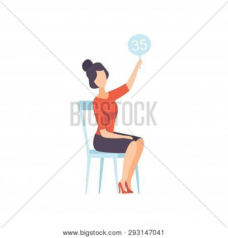 Businesswoman Bidding In Public Auction House, Female Bidder Raising Auction Paddle With Number To B