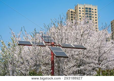 Solar panels with apartment building in the city