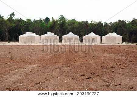 The White Net Plantation House And Brown Soil Ground  At The Rural Of Thailand