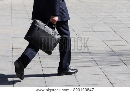 Man With Briefcase Walking On The Street, Person In A Business Suit Rushing To A Meeting. Concept Of