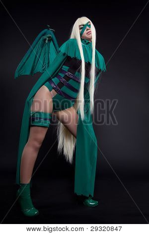 girl posing in green cosplay costume anime character poster