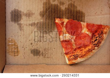 Leftover Pepperoni Pizza Slice In Delivery Box. Last Food Piece Of Popular Italian Style Pizza In Gr