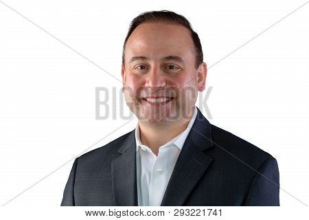 A Portrait Of A Smiling Businessman In A Black Suit With A White Background And Copy Space.