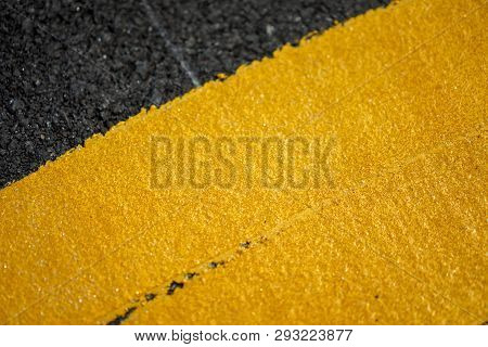 Close Up Fresh Thermoplastic On The Asphalt Road