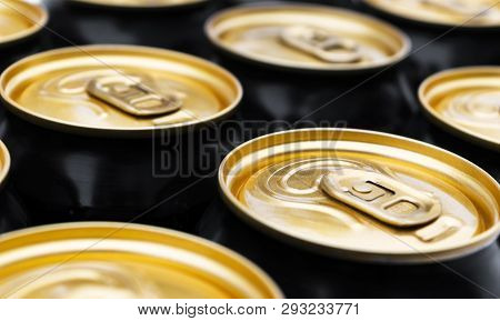 Close Up Photo Of Aluminum Cans In A Raw. Aluminium Can Background. Can Pattern. Aluminum Beverage C