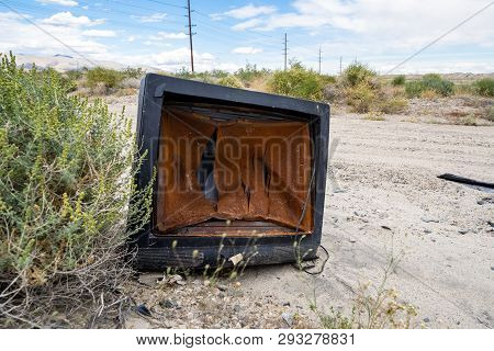 A Broken, Busted Old Crt Tv Set Sits Abandoned And Rotting In The Desert Of California