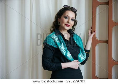 Middle Age Adult Woman Portrait. Smiling Woman Posing Indoors