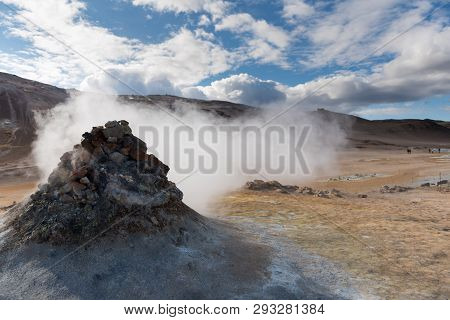 Smoking Fumarole Near Hverir Geothermal Area, Myvatn Lake Area, Iceland. Geothermal Area With Smokin