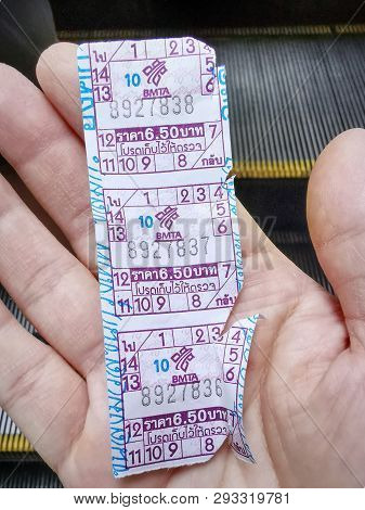 Pathumwan, Bangkok / Thailand - April 3, 2019: Hand Holding Public Bus Fare Tickets