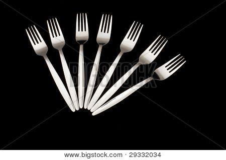 Five Forks Arranged On A Black Background